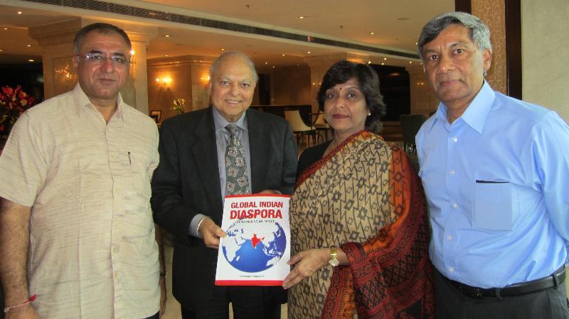 GOPIO officials presenting book to Dr Nisha Dube (VC Barkatullah Univ)