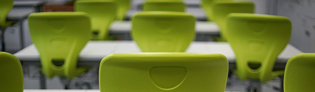 rows of empty chairs in classroom