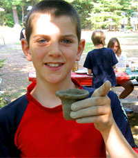 photo of teens making clay pots