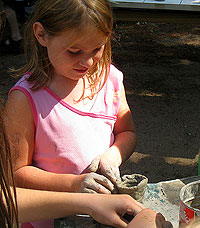photo of girl making clay pot