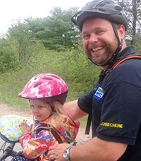 photo of dad and daughter on bike