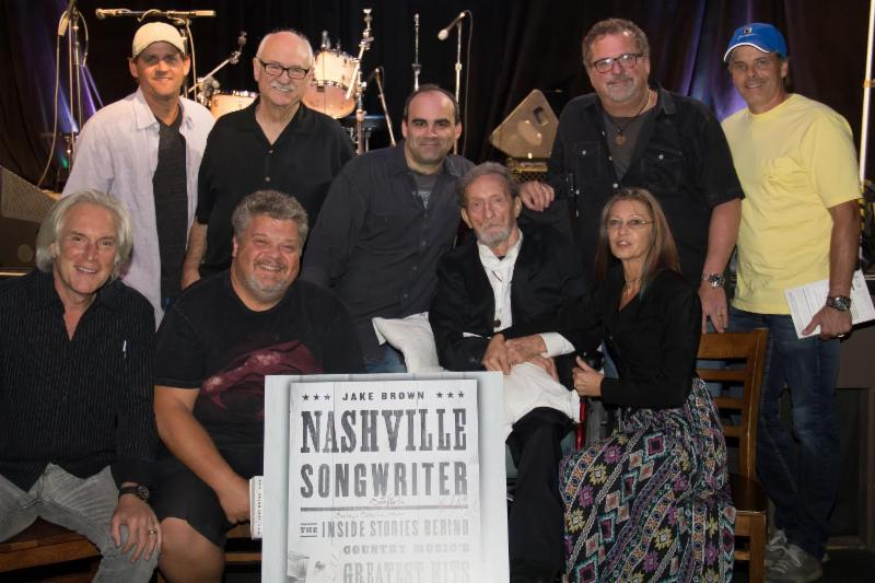 L to R seated are Jeff Silbar, Craig Wiseman, author Jake Brown with arm around Freddy Powers and Catherine Powers.  Standing L to R are Neil Thrasher, Sonny Curtis, Bob DiPiero and Kelley Lovelace   PHOTOGRAPHER credit  Kindell Moore