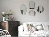 PIC OF VINTAGE MIRRORS IN LIVING ROOM