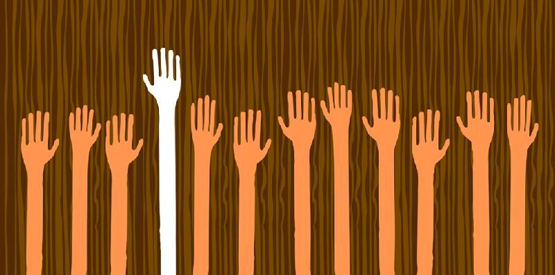 volunteers raising hands