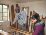 pic of Jimmie and Claudia bundling flooring