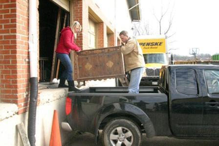PIC OF FOLKS LOADING DRESSER