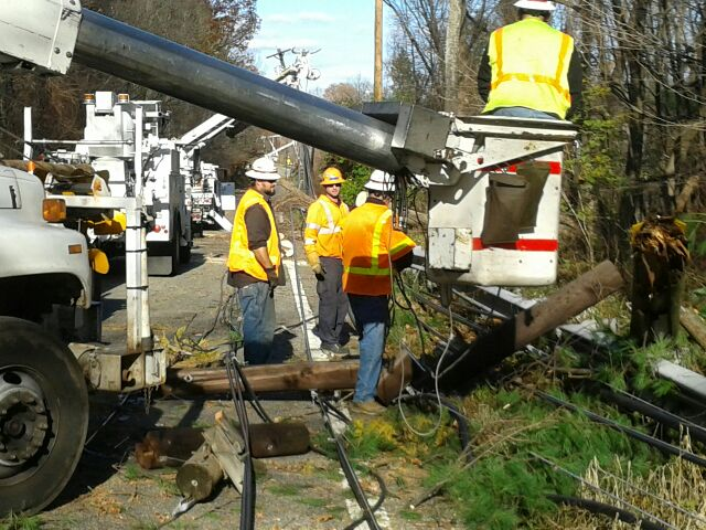 Verizon Crew Repairs Utility Pole