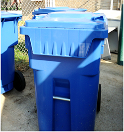 Large blue recycling bin