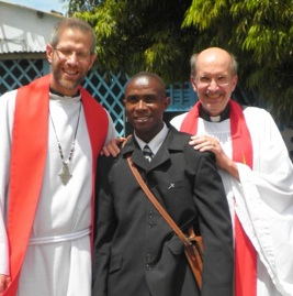 Pastors Chad and Ron with their driver, Norbert.