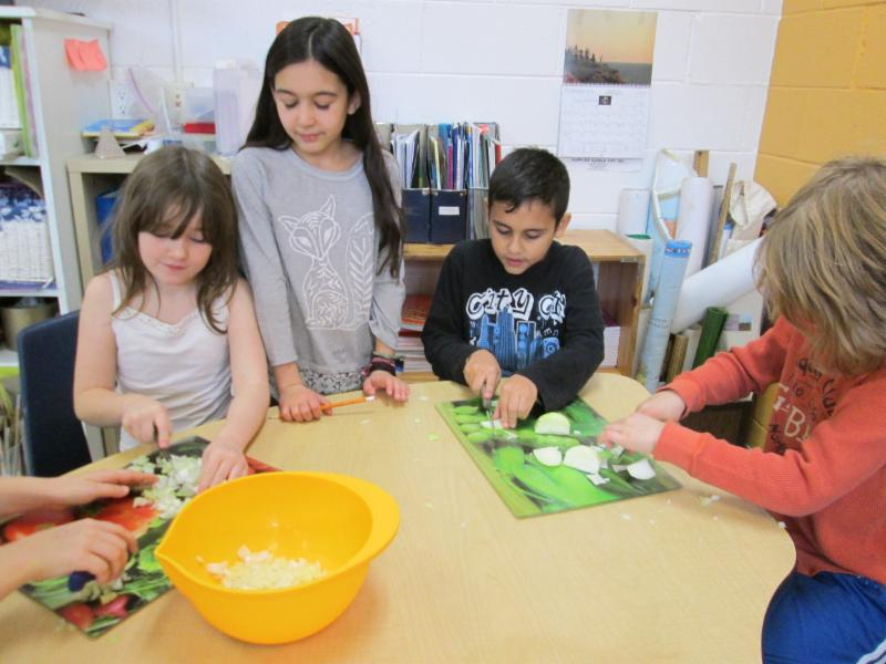 Lower Elementary Children Preparing Onions for Lentil Soup