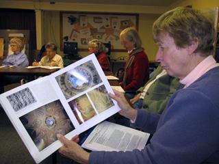 Renaissance Art class students examine a book.