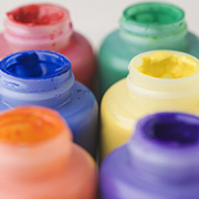 Photo of 6 different color paint containers