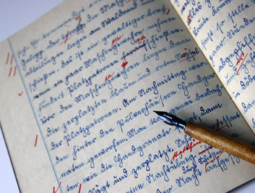 photo of writing in a notebook using a fountain pen