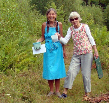 Photo of Western Mountains Senior College members picking blueberries at summer event.