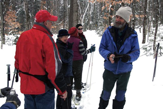 Snowshoeing in Maine woods