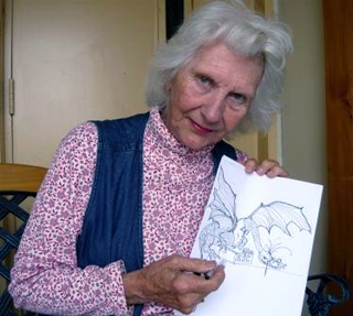 Photo of Starr Kopper holding Jabberwock drawing