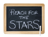 Reach For The Stars written on chalkboard