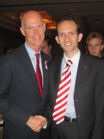 With Rick Scott