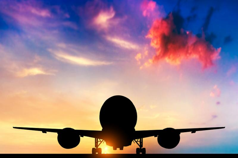 Airplane ready to take off. Silhouette of a big passenger or cargo aircraft, airline at sunset. Transportation