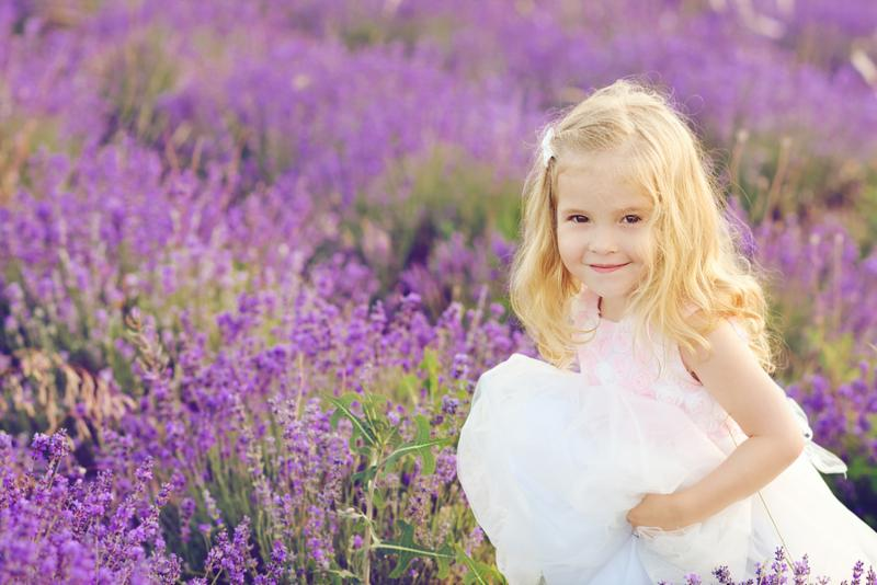 happy girl running in the lavender field