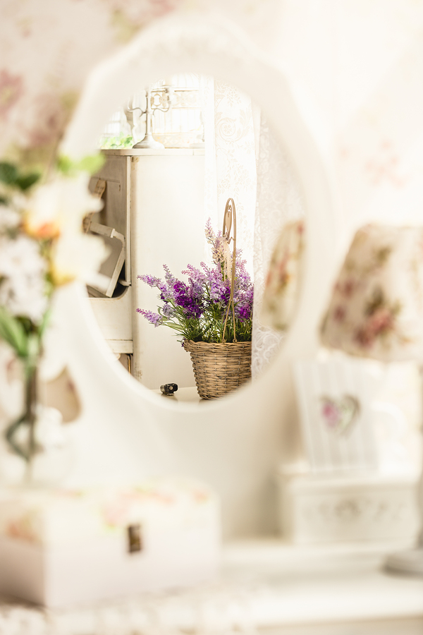 Closeup photo of bunch of lavender reflecting in provance styled mirror