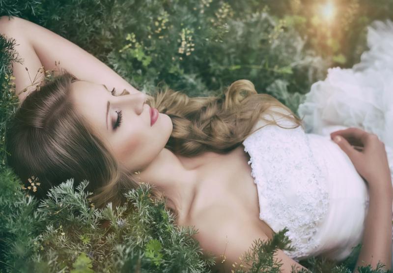 Beautiful bride in white dress in spring garden