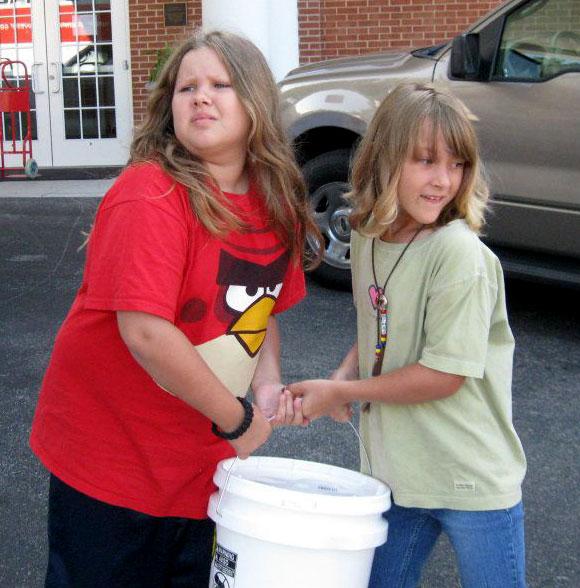 2 children carrying bucket 6-25-12