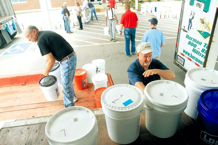 Packing buckets.photo by Mark Large. TDT. 6-22-13