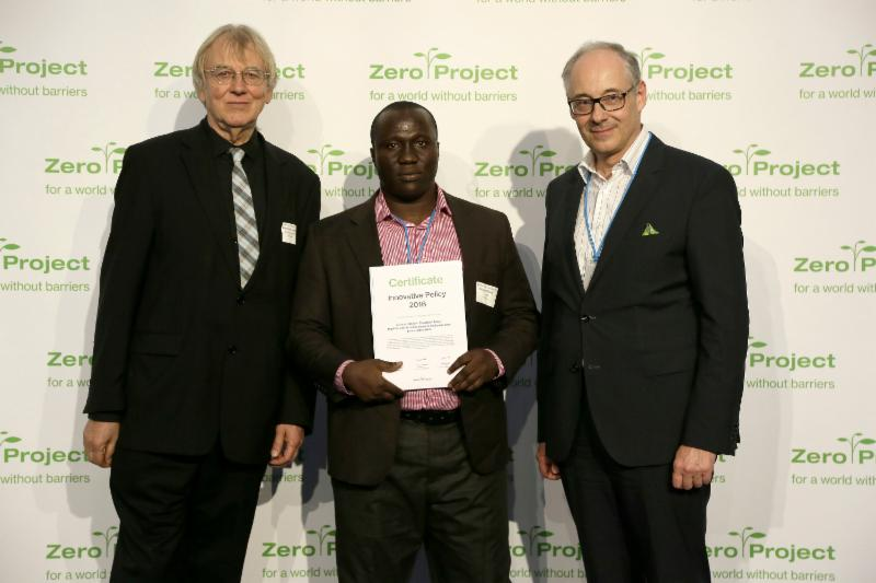 Auberon Jeleel Odoom of Inclusion Ghana accepting award _photo_