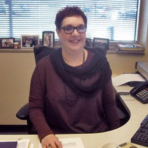 Chris at her desk