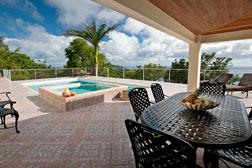 The pool deck at High View villa