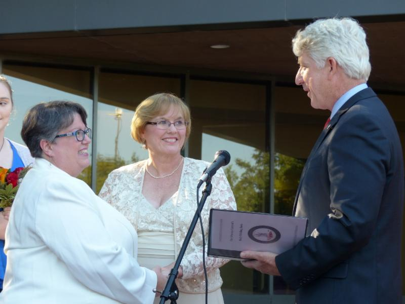 Attorney General Herring performing Carol Schall and Mary Townley's vow renewal on October 6, 2014