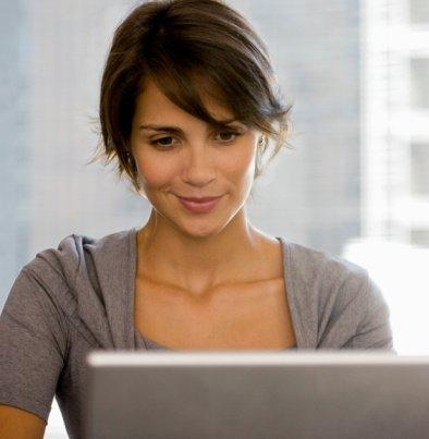 female smile at laptop 2