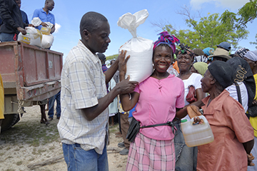 Today, in a first for Haiti, one group of farmers sponsored food aid for another group of farmers in need.