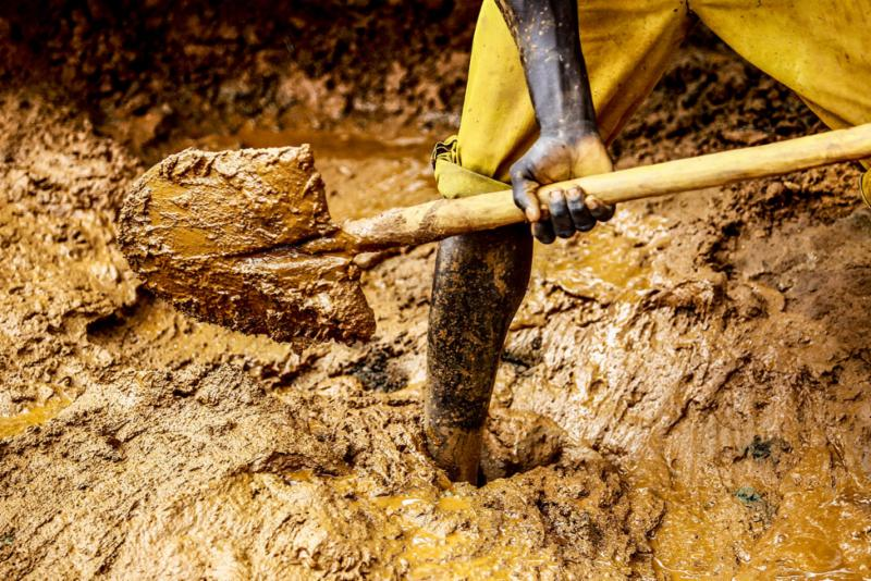 Miner toiling for gold