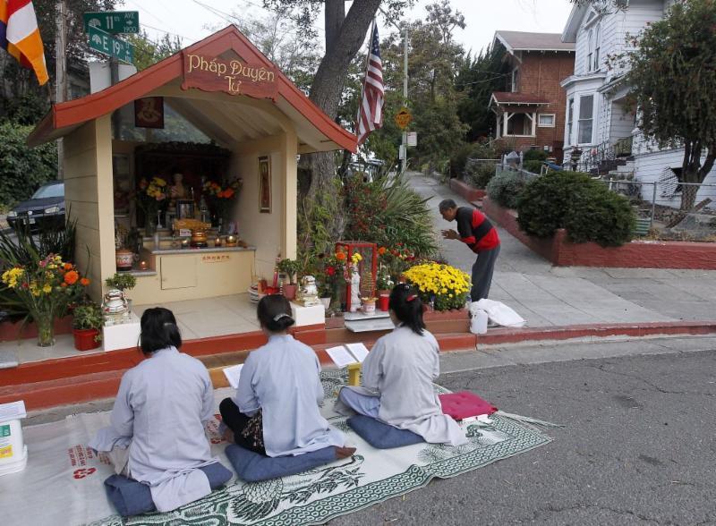 Buddhist worshipers and Oakland street shrine
