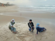 Abuelaish - daughters on beach 210