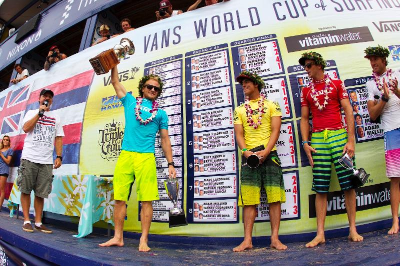 Melling raises the historic VANS World Cup of Surfing trophy. (ASP/Kirstin)