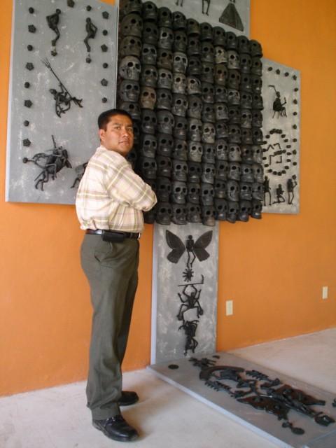 Carlomango with hanging artwork