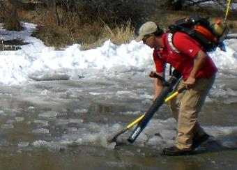 Ice being removed with shovel and blower