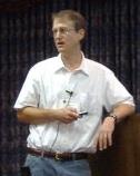 Ellis at podium