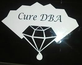 Cure DBA decal on car.