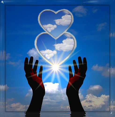 hearts held in sky with sunlight