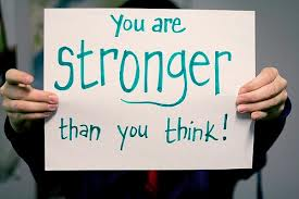 sign being held up that says you are stronger than you think
