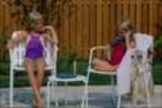Girls talking with phone and by pool