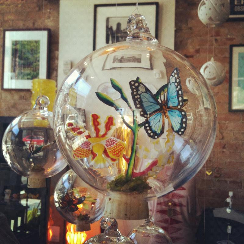 Paper sculpture in glass ball by Sarah Rocheleau