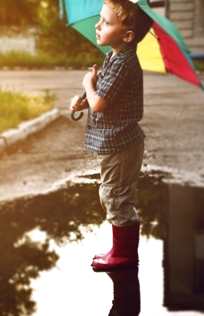 Boy in puddle