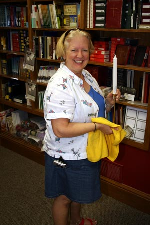 Ann Babington spiffing up the bookstore.