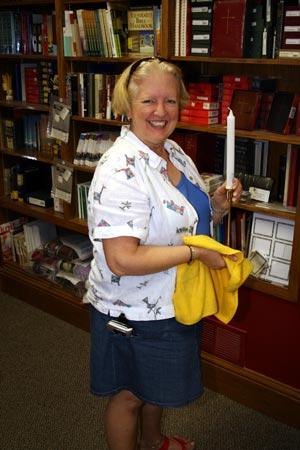 Ann Babington spiffing up the bookstore.