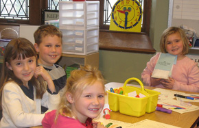 First graders learn about the Good Samaritan.